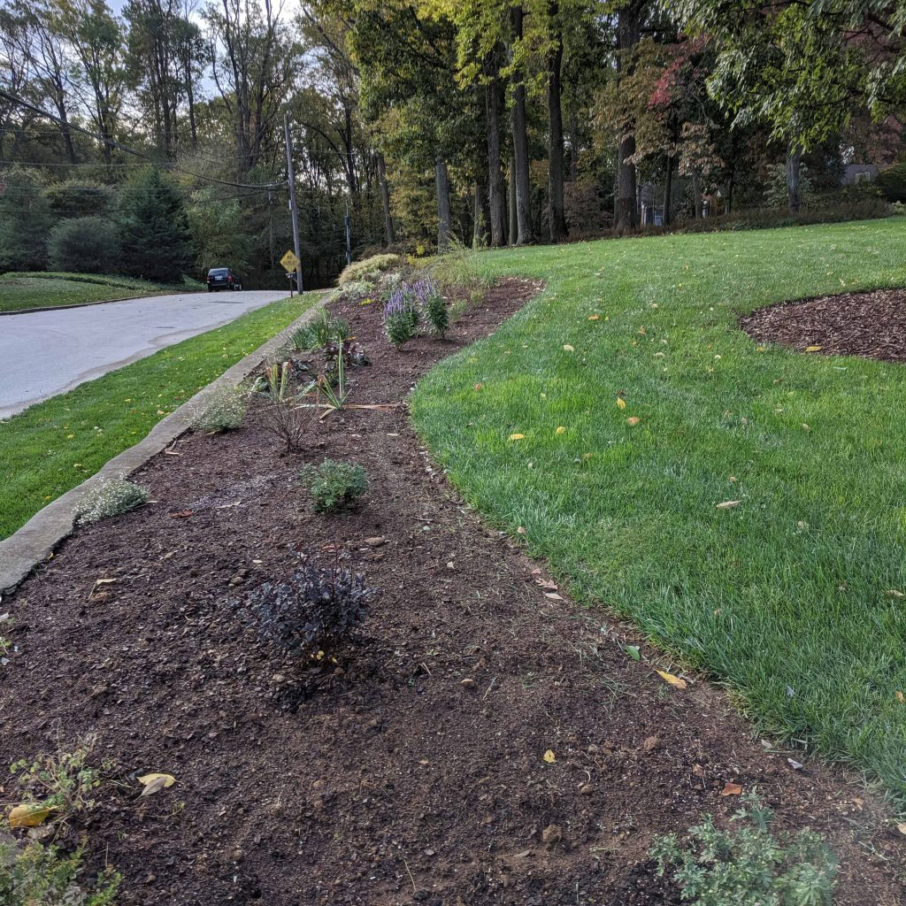 Newly installed garden bed on a slope
